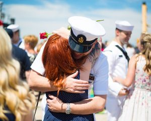 Navy Person Hugging His Wife
